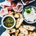 Summer BBQ and picnic season is quickly approaching. One low-stress solution for summer entertaining is creating a bruschetta bar for your friends to enjoy. With three steps you can have an easy appetizer table to impress guests!