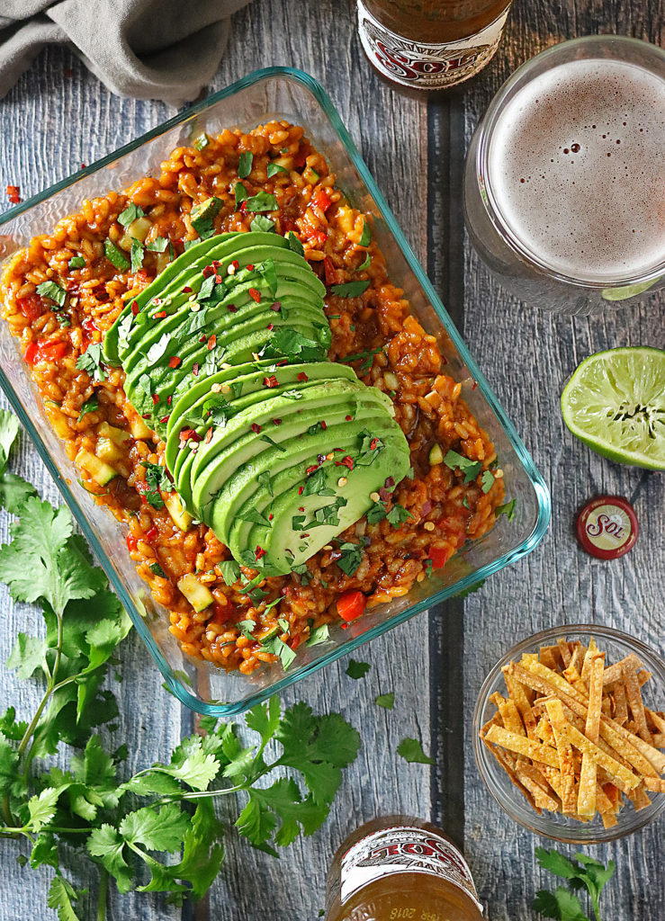 This simple 30-Minute Vegetable Enchilada Risotto is a one-pan recipe perfect for a weeknight meal. This cheap healthy dinner combines zucchini, peppers, onions, cheese, and risotto with enchilada sauce and a secret ingredient that might surprise you!