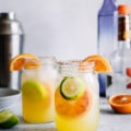 Orange, lemon, lime, and a dash of chili powder give these Spicy Citrus Margaritas a unique flavor that's sure to be a hit at happy hour. The spicy chili lime salted rim gives this fun twist on a classic cocktail the signature look it deserves!