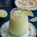 This Frozen Honey Dew Margarita is a tequila-based summer cocktail with a generous dose of fruit and sweet and salty rim. The perfect drink to sip on after a long day, happy hour, or outdoor entertaining with friends.