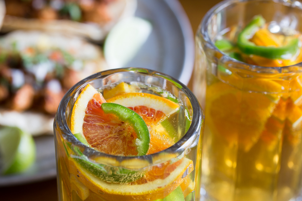 Don't let the wine lovers have all the fun during happy hour! Beer lovers will rejoice over this fresh and fruity Spicy Beer Sangria recipe. This summer cocktail is the perfect balance between fresh squeezed and slightly fizzy.