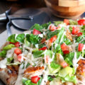 Put a fresh farmers market spin on pizza night with this Grilled Chicken Caesar Salad Pizza! This one-pan meal combines the classic combo of pizza and salad in one slice. A 30-minute meal that's perfect for weeknights or entertaining.
