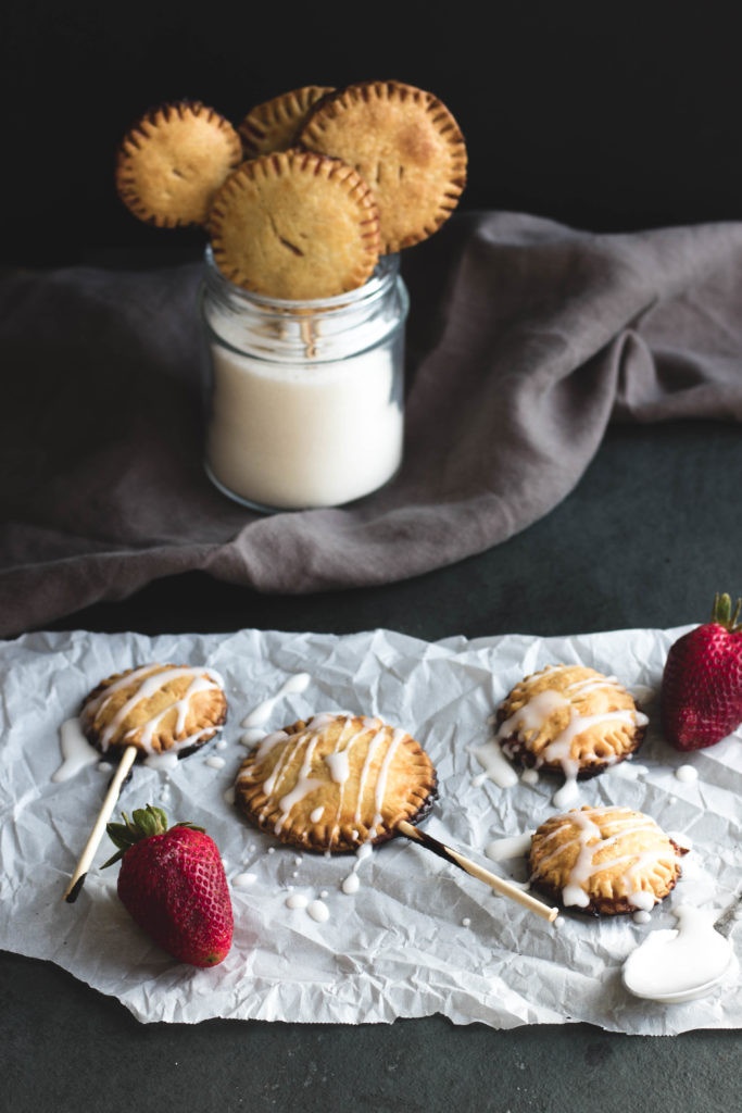 These Strawberry Pie Pops with Vanilla Glaze transform farmers market fruit into an American classic dessert on a stick. This hand-held, mini dessert is perfect for outdoor entertaining because there are no utensils required!