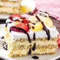 This Banana Split Icebox Cake is the perfect no-bake dessert for summer entertaining. Cold and creamy, feeds a crowd, full of fresh farmers market produce, and sure to be a hit for potlucks.
