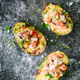 It's outdoor grilling season so why not change up your grilling routine with some southwestern grilled avocados? Stuffed with ground turkey and all of your favorite flavors of Mexican cuisine, these stuffed grilled avocados are the perfect light weeknight dinner or weekend lunch.