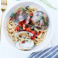 This Garlicky Clams Linguine recipe is a simple 30-minute meal you can make at home. This restaurant-style meal is made of linguine pasta with clams coated in a buttery garlic sauce, tomatoes, and garden-fresh basil.