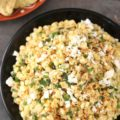 If you're hosting happy hour at home or throwing a tailgate party, you need this Elote Dip on the menu. Just like Mexican Street Corn, but in dip form, this is a 15-minute appetizer. Sautéed corn, cilantro, garlic, chili powder, Cojita, and mayo make the best dip at the party!