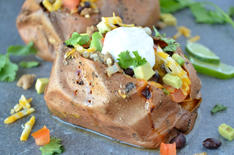 Introducing your new favorite Taco Tuesday recipe...Taco Stuffed Sweet Potatoes. This delicious cheap healthy meal is naturally gluten free. A simple, budget-friendly meal that's perfect for a weeknight dinner.