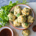 These Vietnamese-Style Chicken Meatballs are great for outdoor entertaining. Baked chicken meatballs made with fresh lemongrass and the flavors of Asia, when paired with a spicy dipping sauce, are the perfect party appetizer.