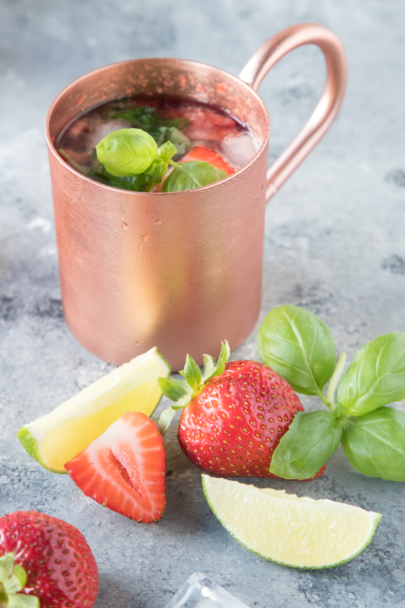 Head to your farmers market to pick up the fresh produce you need to make this 5-Ingredient Basil Strawberry Moscow Mule. Vodka, ginger beer, and fresh produce make the perfect summer cocktail, but you can enjoy it all year long!