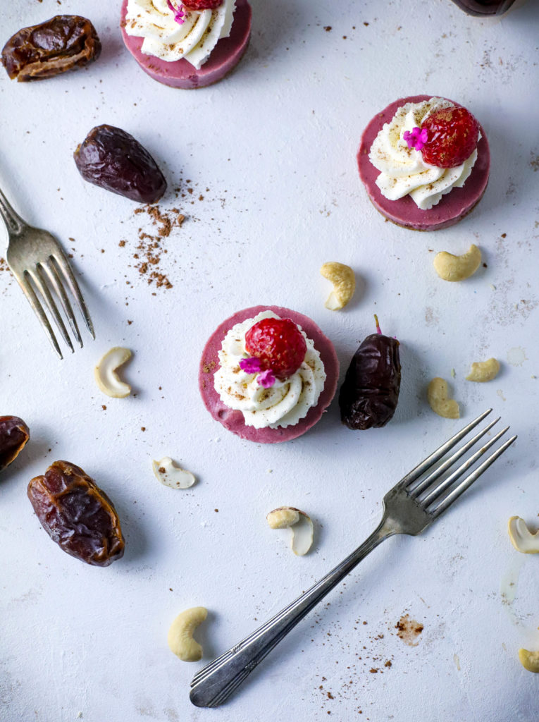 Impress party guests with these simple Vegan Raspberry Mini Cheesecakes. These small bites are a refined sugar-free, simple no-bake dessert. A little on the lighter side, everyone will love this decadent mini dessert!