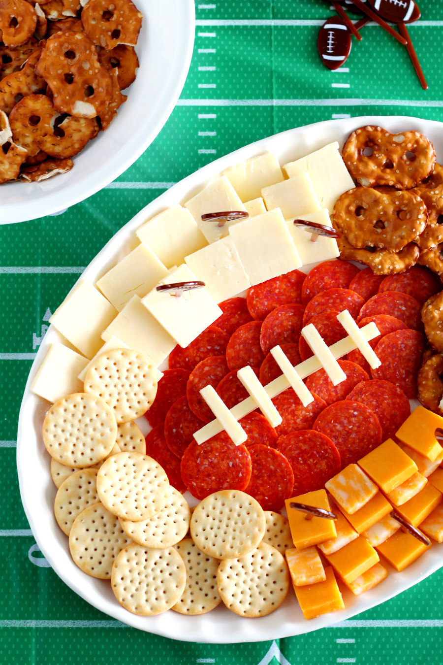 Affordable entertaining during football season isn't that hard when you bust out this Football Charcuterie Platter! This simple tailgating appetizer is sure to score a touchdown with party guests.
