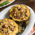If you're cooking for two this holiday season, this Sausage Stuffing Acorn Squash needs to be on your holiday menu. Fresh produce, pork sausage, and cranberries dress up store-bought stuffing in this single-serve side dish.