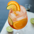 The Aperol Spritz is making a comeback for a reason! This Italian classic cocktail consists of Aperol, Proscecco, orange and lime slices, and club soda. Perfect for dinner parties or happy hour, the vibrant color and flavors add to the joy of any occasion!