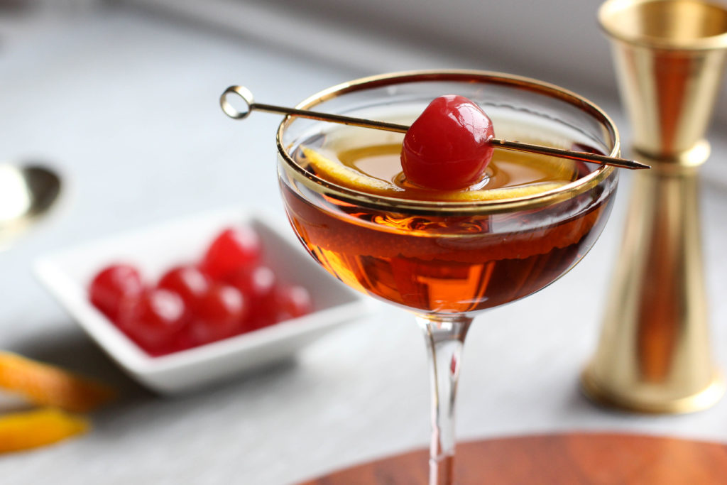 This Whiskey Manhattan Classic Cocktail will satisfy your cravings for a familiar drink with no fancy ingredients and no unique twists. This boozy cocktail is served strait up with a bitter flavor that's followed by a hint of sweetness. Perfect for happy hour!