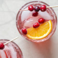 This 4-ingredient Cranberry Prosecco Aperol Spritzer is a festive twist on a classic cocktail. With the addition of cranberry simple syrup and orange slices, the bold, seasonal flavors of this wine-based cocktail are perfect for holiday entertaining or happy hour!
