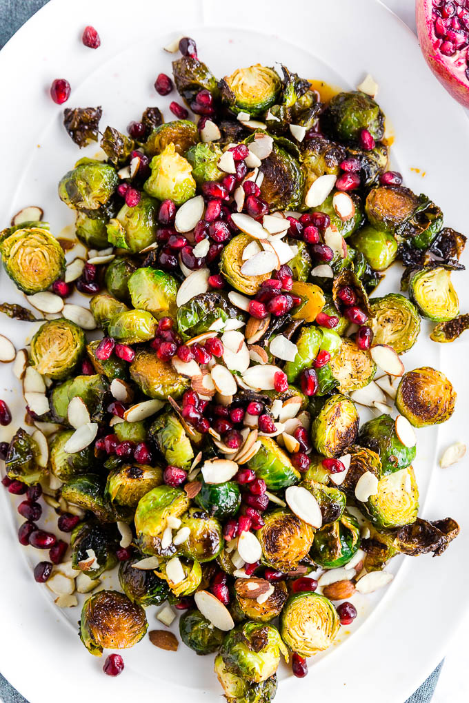 Looking for a 30-minute side dish easy enough for a weeknight meal, yet fancy enough for entertaining guests? This Pomegranate Roasted Brussels Sprouts recipe is the seasonal side dish you need! Sweet and tart, this simple side dish will enhance any meal!