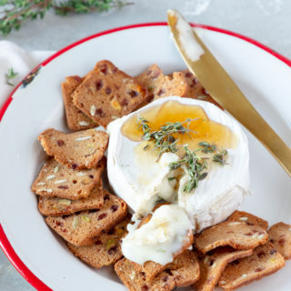 This Honey Thyme Baked Brie Appetizer is perfect for a holiday party, family gathering, or office potluck. This gooey, melty, 3-ingredient appetizer looks so elegant, no one will know it only took you 15 minutes to prepare!