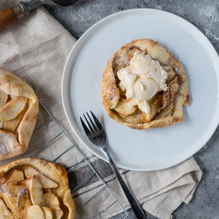 mThese Apple Galette Mini Tarts are elegantly simple and delightfully rustic. A single-serve dessert perfect for entertaining, this mini dessert includes tender-baked apple with cinnamon, topped on gorgeous, light, and buttery tart shells. Sure to impress the pickiest dessert lovers!
