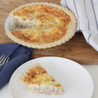 Looking for a Sunday Brunch to impress guests? This Creamy Cheesy Ham Quiche recipe is it! This classic breakfast is a one-pan meal that's simple to make and will be loved by all!