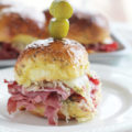 Looking for a hearty, 30-minute appetizer for game day? These Reuben Slider Sandwiches are made with classic corned beef, sauerkraut, cheese, and a zippy sandwich sauce. These mini deli-style sandwiches are an easy appetizer that will impress a crowd!