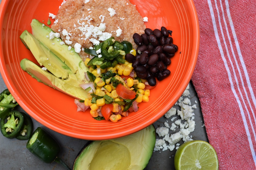 This Spicy Mexican Grits Bowl with fresh corn salsa is a healthy budget meal that doesn't sacrifice on flavor or wholesome ingredients. This classic southern dish is loaded with Mexican flare and you won't be able to beat this nutritious, hearty, meat-free meal!