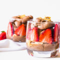 Eating better doesn't mean you have to sacrifice dessert, you just need to choose more wisely. This Chocolate Coconut Whip Parfait is a healthier dessert option that is refined sugar free. This lower calorie dessert is a dairy-free whip cream made with coconut milk, layered with fresh berries and toasted almonds.
