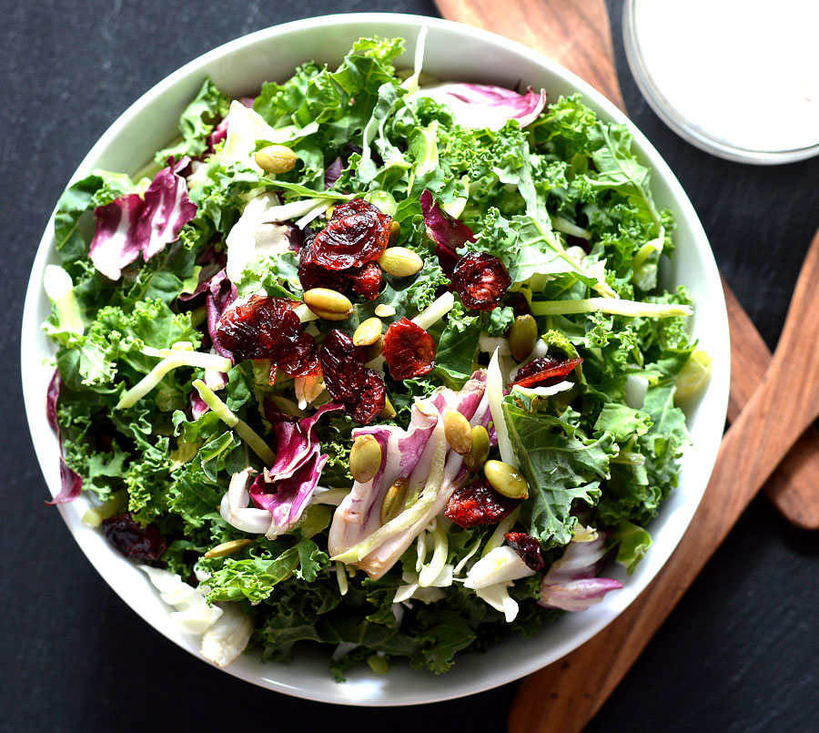 Kale is one of the most nutrient-dense foods on the planet. It's loaded with antioxidants and vitamin C, and lowering cholesterol and staving off cancer are just a couple of the amazing kale health benefits you need to know about!