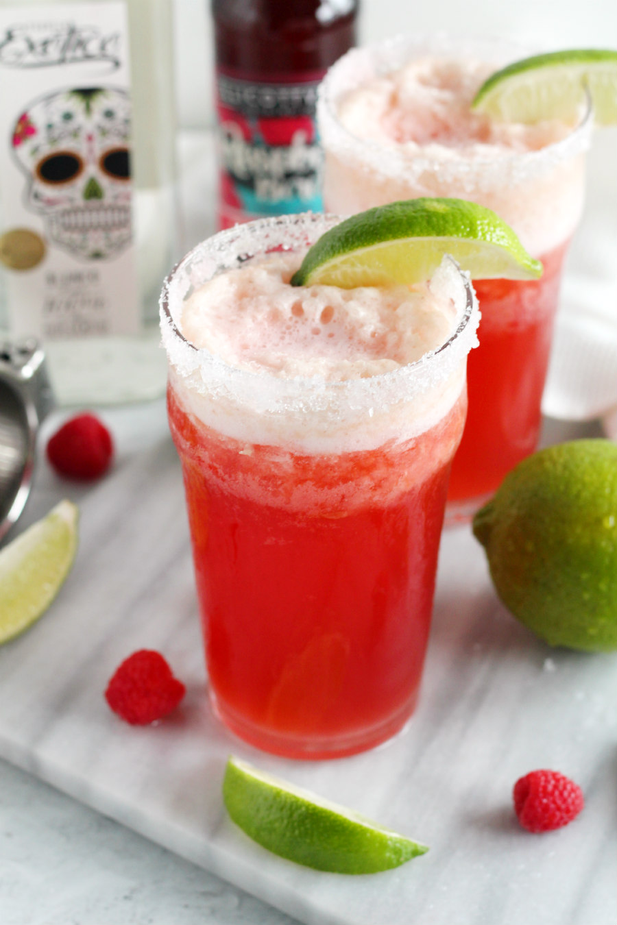 This Raspberry Beergarita Recipe is made with raspberry flavored beer and classic margarita ingredients.  It's a fruity beer cocktail that combines two popular adult beverages into one delicious drink! Just blend 6 ingredients together for the perfect spring cocktail!