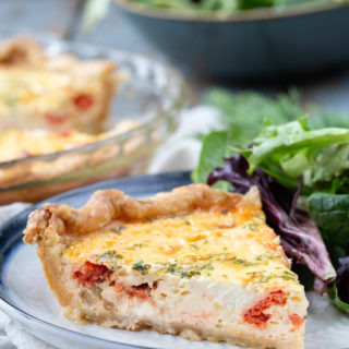Elevate your Sunday brunch menu with this Smoked Salmon Quiche. With all of the flavors of a favorite breakfast classic - bagels, cream cheese, and salmon - it pairs perfectly with your favorite Mimosa recipe.