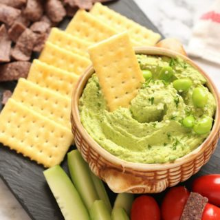 This super simple vegan and gluten free Edamame Hummus is an evergreen dip that's perfect for a healthy appetizer, sandwich spread, or as a delicious midday snack!