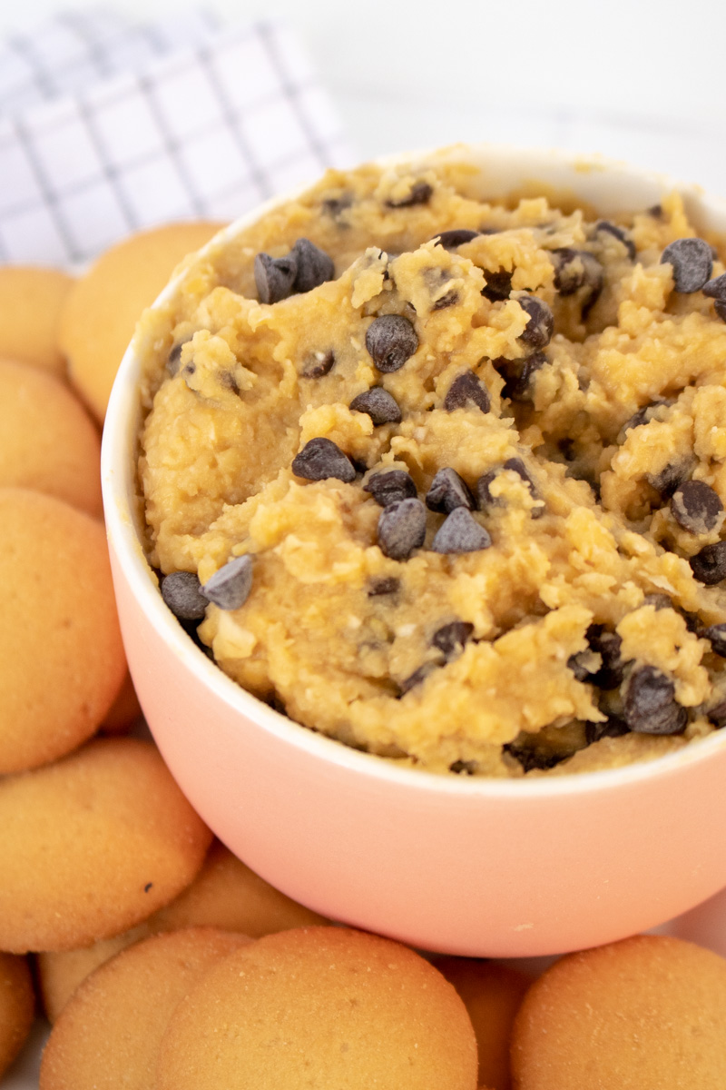 With 10 minutes and a few pantry staples, you'll transform traditional hummus into this Chocolate Chip Cookie Dough Dessert Hummus! A gluten-free appetizer or healthier dessert that's perfect for summer entertaining since there's no baking involved!