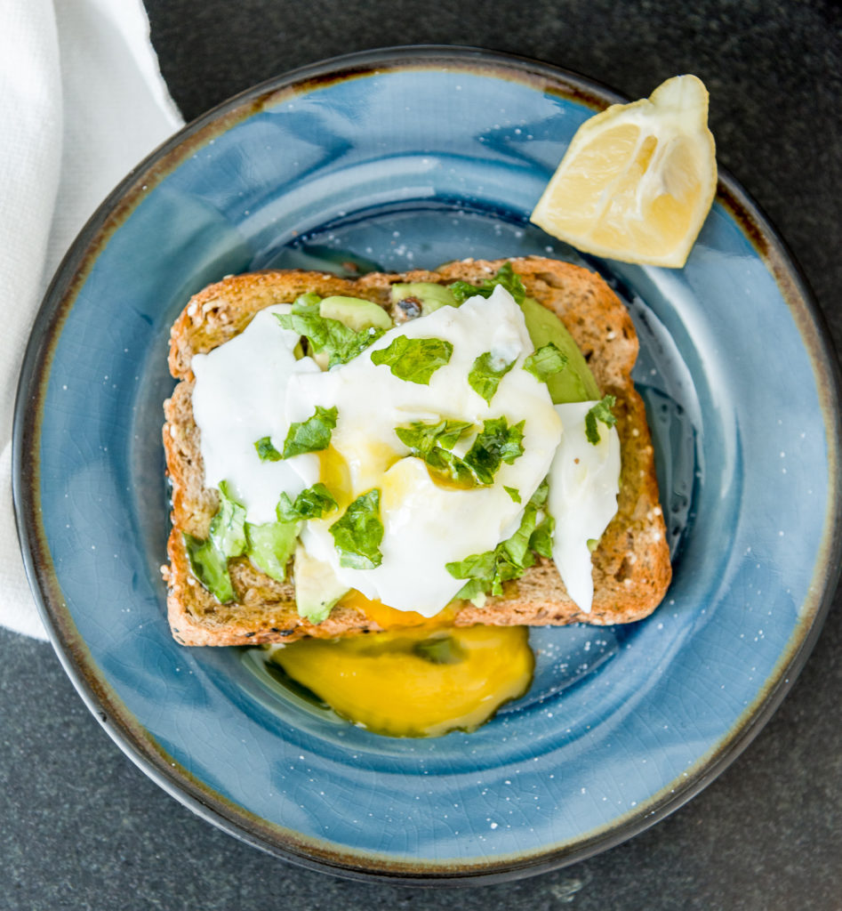 Need an easy 10-minute, hearty breakfast? Try this Poached Egg Avocado Toast! A healthy whole food breakfast with protein and nutrients. Learn how to make a poached egg the easy way!