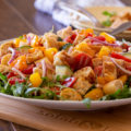 Classic Italian Tuscan Panzanella Bread Salad is made with cubes of crusty bread, farmers market fresh ripe tomatoes, cucumbers, red onions, and basil. All tossed in a fragrant basil pesto vinaigrette.
