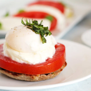 If you enjoy the traditional Italian flavors of Caprese Salad, you'll love this Poached Eggs Caprese recipe. Poached eggs on English muffins with tomato, basil, pesto, and fresh mozzarella for a hearty breakfast or Sunday brunch!