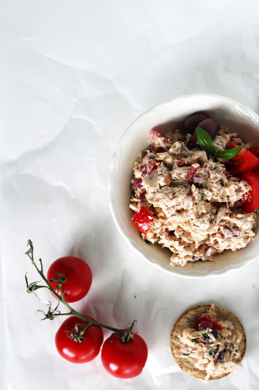 You'll love this Mediterranean Chicken Salad recipe. It's a guilt-free lunch with tender chicken, Greek yogurt dressing, Campari tomatoes, and Kalamata olives. A few surprise ingredients give this lightened up chicken salad a unique taste.