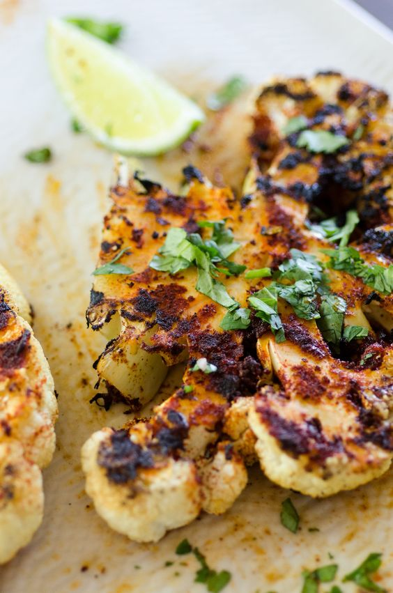 What gets you most excited about grilling season? If you said hamburgers or steaks, you're missing out on the magic of outdoor grilling season! Grilled vegetables are delicious with a good set of grill marks, and these Chipotle Lime Grilled Cauliflower Steaks are sure to become a family favorite!
