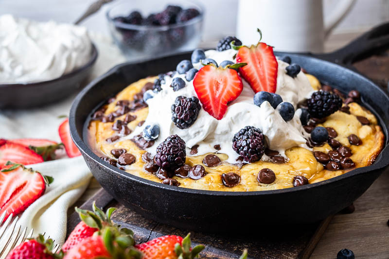 Kick up your Sunday brunch game when you make this impressive Cast Iron Chocolate Chip Pancake. Fluffy pancake batter is baked to perfection in about 30 minutes in your cast iron skillet. Top with your favorite farmers market fruit!