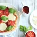 This easy grilled pizza recipe takes just 15 minutes. Whether you decide to grill a Caprese Pizza or a meatier variety, grilled pizza takes outdoor grilling to a new level. The homemade pizza dough really makes the meal!