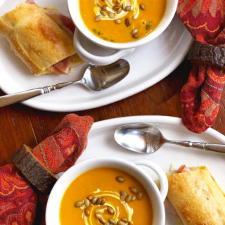 Cozy up on a chilly evening with this homemade Pumpkin Soup with Gruyere Grilled Cheese Ham Sandwich. This simple deli-style meal is the perfect comfort food for lunch or dinner.