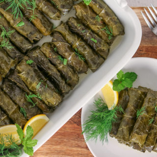 These Stuffed Grape Leaves are a rice-filled, Mediterranean appetizer or side dish flavored with mint, dill, and lemon. These Vegetarian Dolmas are a healthy comfort food perfect for entertaining and potlucks