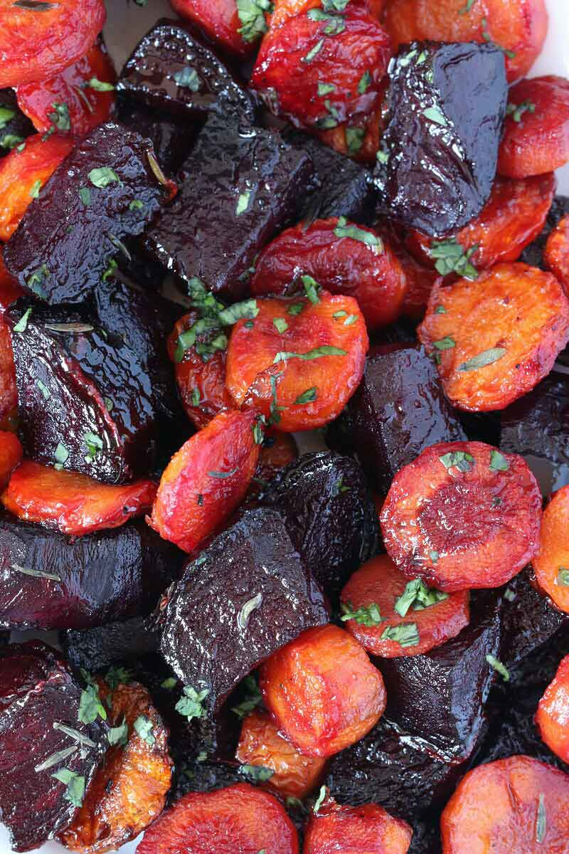 Maple-Roasted Beet Carrot Side Dish is the perfect sweet compliment to any savory meal. A simple, 30-minute side dish for your holiday dinner or weeknight meal.