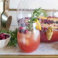 Savor seasonal flavors and ring in the new year with this Spiked Seltzer Holiday Punch! This rum-based cocktail combines trendy spiked seltzer with cranberry juice and orange juice. Garnish with fresh pomegranate seeds and citrus for a festive flair!