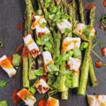 This grilled asparagus and halloumi salad is topped with spicy harissa vinaigrette, and is the perfect Spring/Summertime grilling recipe! Seasonal, fresh, and ready in only 15 minutes!