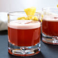 This Tropical Americano Cocktail is just as pretty as it is delicious. It's perfect for a quite after dinner drink or celebrating a special occasion. | HostessAtHeart.com