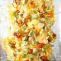Make your Mother's Day brunch more festive when you serve up this simple Breakfast Nachos recipe. Eggs, chicken hot dogs, cheese, avocado, tomatoes, and hash browns top tortilla chips for a unique flavor sensation.
