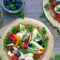 You will get the most of your famers market produce when you make this customizable, gluten-free Cauliflower Crust Veggie Fruit Pizza recipe this summer. A personal-sized pizza that's perfect for lunch!