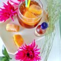 This is not your mama's sweet tea, y'all. This remarkable Sweet Tea Cocktail recipe combines your mama's favorite home brew with fresh peaches and rum. This all-star recipe will become your new summer obsession!