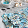 Adorned with edible glitter and luster dust, this Magical Mermaid Chocolate Bark will be a hit at any party. Adored by the kids and the kids at heart, everyone needs more color in their life!