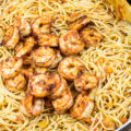 This 30-Minute One-Pot Shrimp Pasta Dinner is an easy dinner with simple ingredients. The shrimp is perfectly juicy and filled with flavor, and the pasta is tossed in a garlicky tomato sauce that's sure to be loved by all!